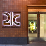 An image of a 21C Museum Hotel entrance. The company offers its employees DailyPay benefits.