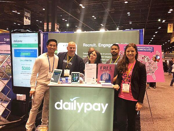 The DailyPay team at SHRM 2018. DailyPay daily payment app, pictured here, lets employees access instant payments and makes payroll easier for HR managers.