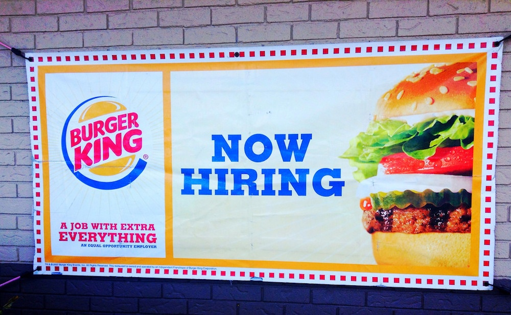 A now hiring image at Burger King. Millennials can be challenging to recruit and retain.